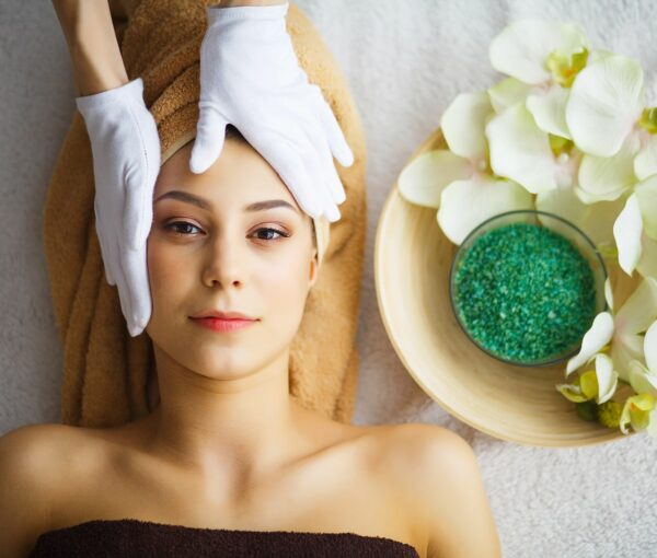 beauty-care-cosmetologist-makes-face-massage-min